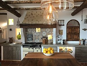 Rustic kitchen spanish style. Wood beams and pattern tiles